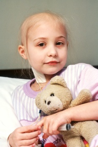Young_patient_holds_teddy_bear